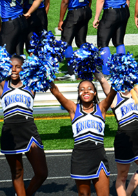 """High School North Cheerleaders"", 9/22/12. Licensed through Creative Commons. https://creativecommons.org/licenses/by/2.0/"